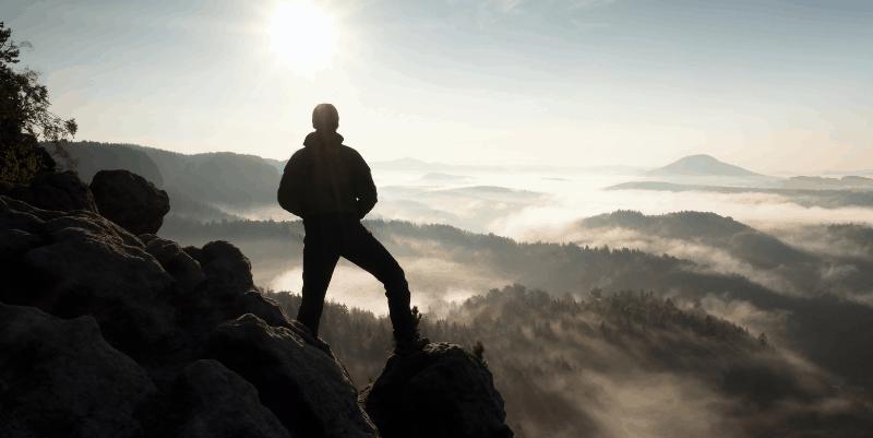 man-on-a-mountain-peak