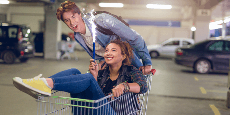 couple-celebrating-in-a-shopping-cart